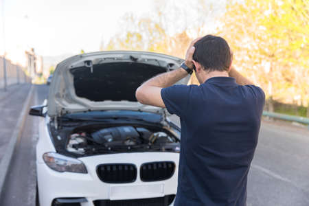 sad man with broken car in road Standard-Bild
