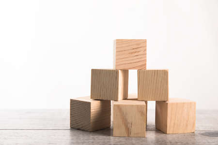 Wooden toy cubes isolated on a white Standard-Bild