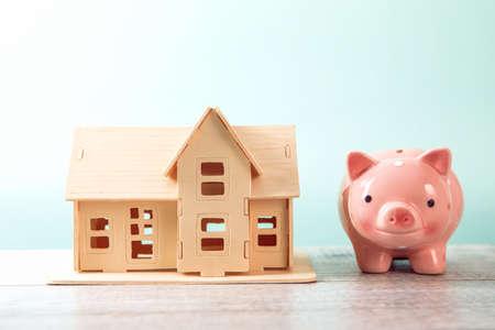 real estate, piggy bank with house model Standard-Bild