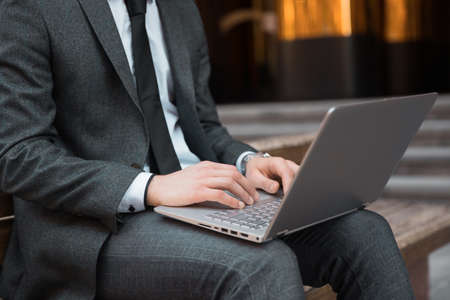man working in computer in street