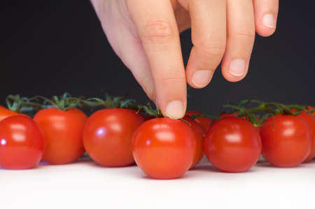 hand gripper: Women catch a tomato from the table Stock Photo