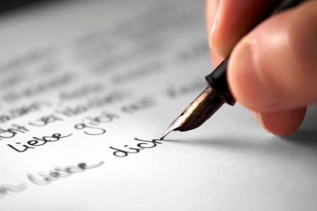 poem: Women�s hand writing a love poem Stock Photo