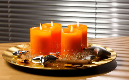 snugly: Four advent candles on a golden plate Stock Photo