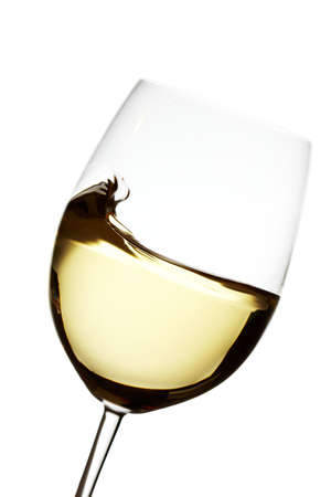 Wave into a white wine glass ober white backround backlighted Stock Photo - 7005366