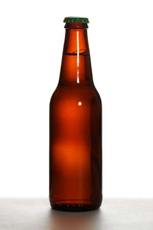 Brown beer bottle with green cap on white backround Stok Fotoğraf