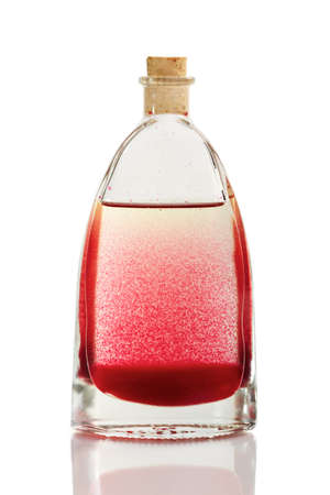 mingle: Red and yellow liquid in a bottle with cork