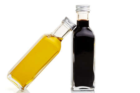balsamic: Oil bottle leans at a vinegar bottle