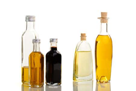 Vijf flessen van olie en azijn in verschillende overzichts- en kleur Stockfoto