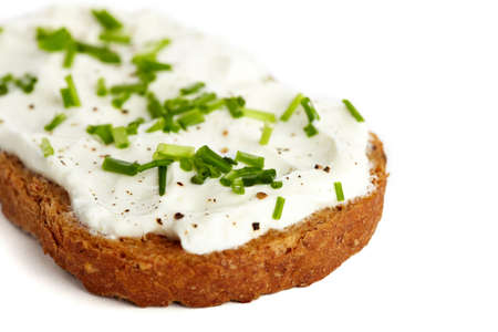 chive: Roasted bread with cream cheese and chives, isolated on white Stock Photo
