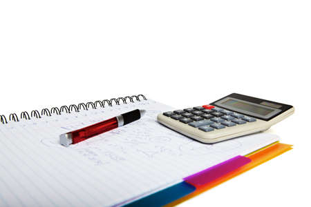 formulae: Calculator on a write pad with a collection of formulae