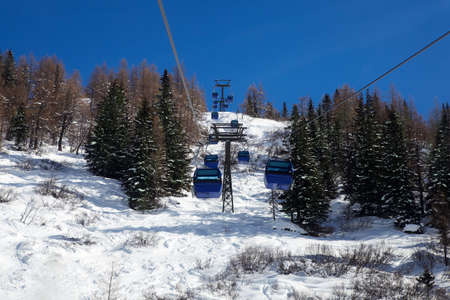 Blue ropeway to ski area in the snow photo