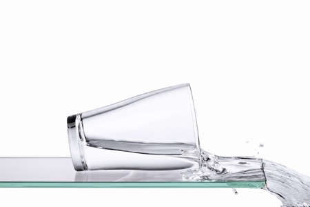 Clean spilling glass of water on a glass panel / surface Stock Photo - 9183550