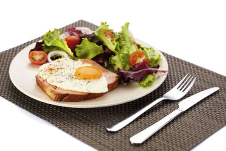 Dish of liver loaf, fried egg and salad photo