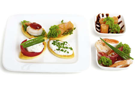 Variation of different starters with seafood and herbs Stock Photo - 9998043