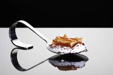starter: Appetizer spoon with honey cake on cream Stock Photo
