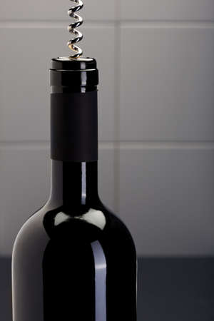 cork screw: Open a bottle of red wine with a cork screw Stock Photo
