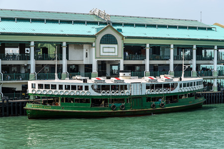 ferries: Hong Kong - October 13 2014: The Star Ferry, or The Star Ferry Company, is a passenger ferry service operator and tourist attraction in Hong Kong.