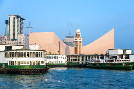 water s edge: HONG KONG, CHINA - January 17 2015: Cultural Centre and the Hong Kong Clock Tower is the eastern node of several tourist attractions along the waterfront the area including the Museum of Art..