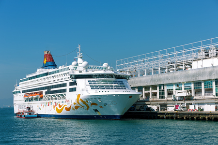 pisces star: Hong Kong, China - December 30, 2014: Star Cruises Pisces docked at Victoria Harbor, Hong Kong Hongkong is a major tourist city in Asia, More than 40000000 visitors a year.. Editorial