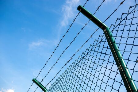 razor wire: Razor Wire Above a Fence