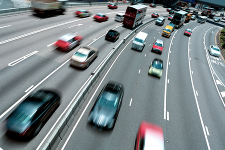 crowded street: Traffic on multiple lane highway with motion blur