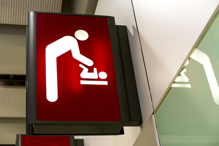 diaper changing table: Baby Changing Sign Lightbox in the airport