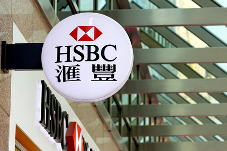 . Hong Kong - December 30, 2014: HSBC logo is displayed outside a branch in Kowloon, Hong Kong HSBC Holdings is a global financial services company.
