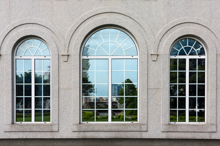 building wall: Three arch windows at stone building Stock Photo