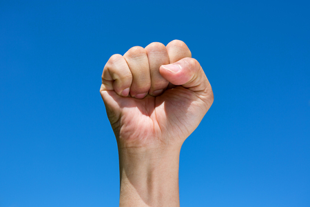 Fist with sky at background