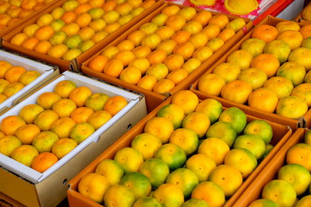 Fresh tangerines in a street market Stock Photo