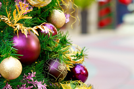Close-up Christmas tree and decoration with colorful balls