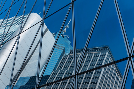 Mirrored office buildings Stock Photo