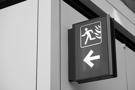 Fire Exit Sign Lightbox in the airport  (black and white)