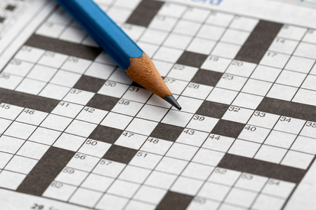 Crossword Puzzle with pencil Imagens