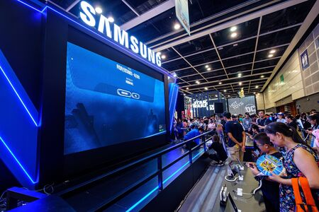 Hong Kong - July 30, 2019: Visitors are seen playing a Samsung gaming the 21th ACGHK2019 Ani-Com & Games event in Hong Kong.