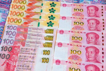 Renminbi and Hong Kong dollar banknotes Imagens