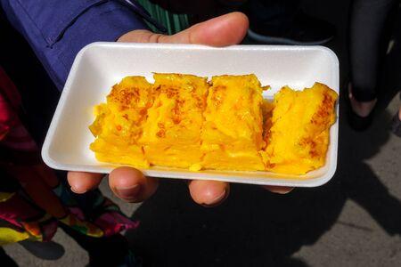Closeup of women hands holding tamagoyaki