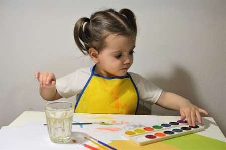 The little girl draws enthusiastically.