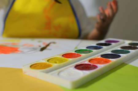 The child draws with watercolors. 写真素材