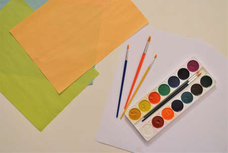 Watercolor, paper on the table