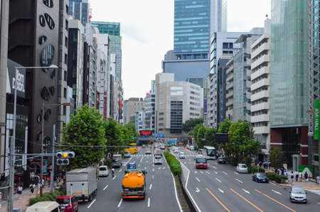 Japan, a large metropolis during the day. A close up of a busy city street