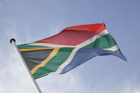 South African Flag against Blue Background