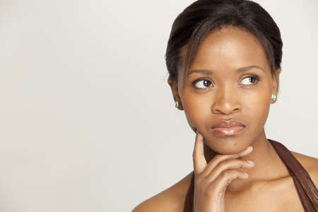 black woman face: Young black woman looking pensive