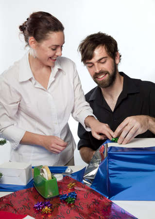 Couple preparing Christmas presents Stock Photo - 5911572