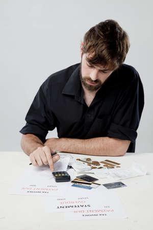 Man budgeting using a calculator Stock Photo