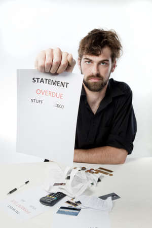 Man demanding explanation for an overdue statement photo