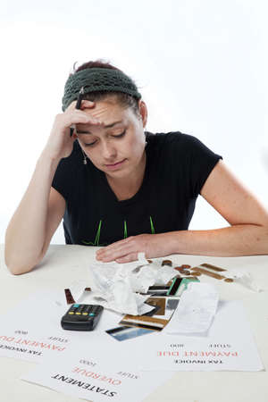 concerned: Frustrated woman looking worried and depressed about her finances Stock Photo