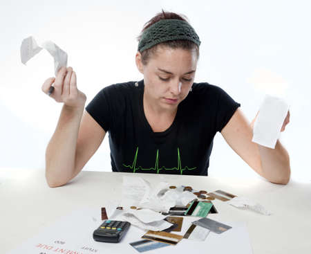 Frustrated woman looking frustrated about her finances Stock Photo