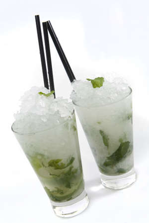 highball: Mojito Rum cocktail on white background in highball tumbler.