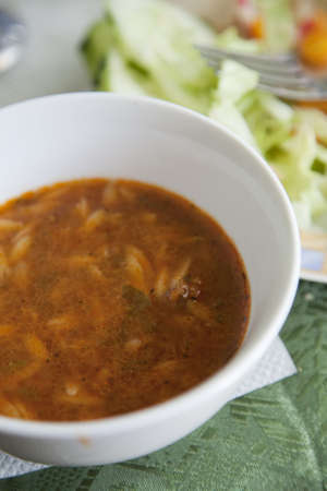 Spicy vegetable and noodle soup from Libya. Stock Photo